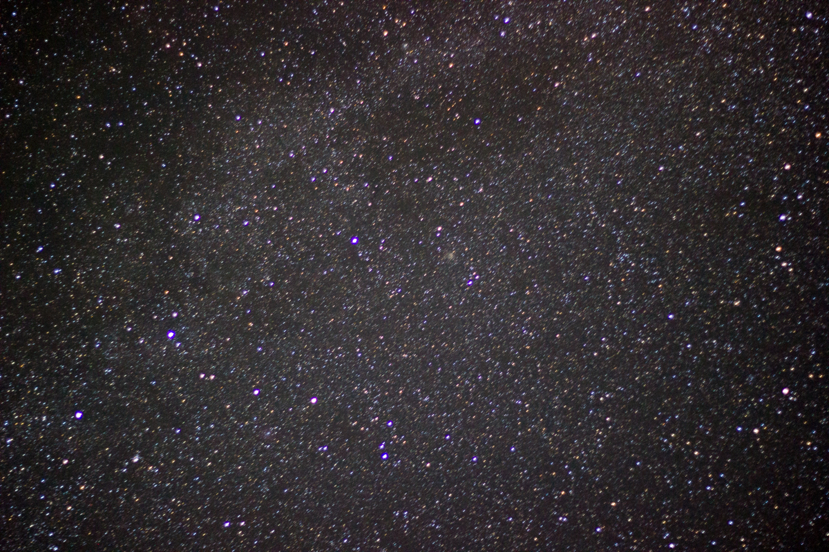 A photo of stars in front of a gray haze